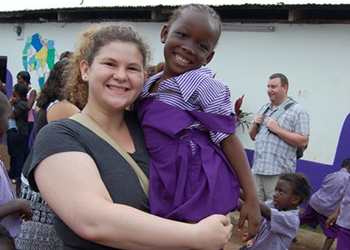 Author, Annie Keenon, with young girl in Ghana