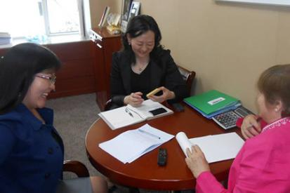 Two Mongolian women meet with U.S. representative from Empower Partnerships