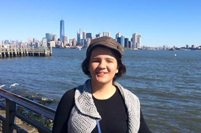 Pinar with NY skyline and water behind her