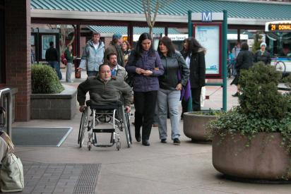 wheelchair user at bus terminal