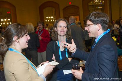 Two MIUSA staff talk with a study abroad director at  2013 CIEE annual conference
