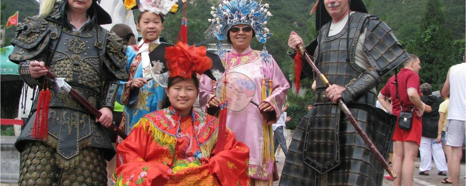 Photo: Study abroad students including a wheelchair user in traditional Chinese designs on the Great Wall