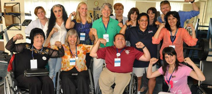 People with and without disabilities flex their arms to show their strength.