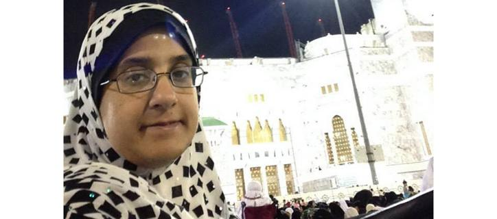 Picture of Bushra with a mosque in the background