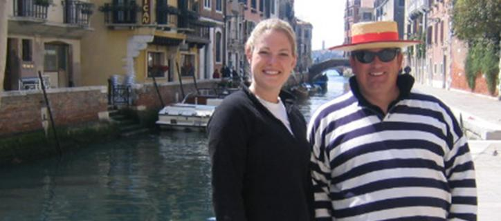 Loren stands next to a gondola operator during an excursion in Venice.