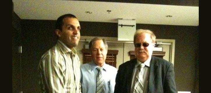 Mounir with two U.S. professionals