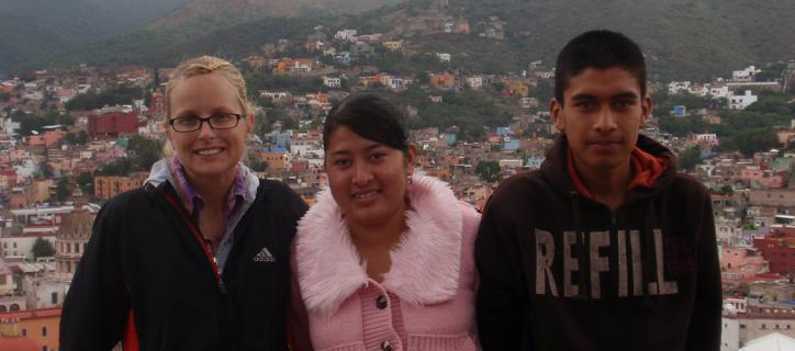 Mallory stands with two of the Deaf Mexican students she worked with.
