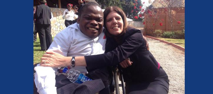Rebecca hugging a Zimbabwean student who is a wheelchair user.