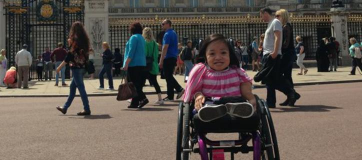 Xuan in her wheelchair outside Buckingham Palace