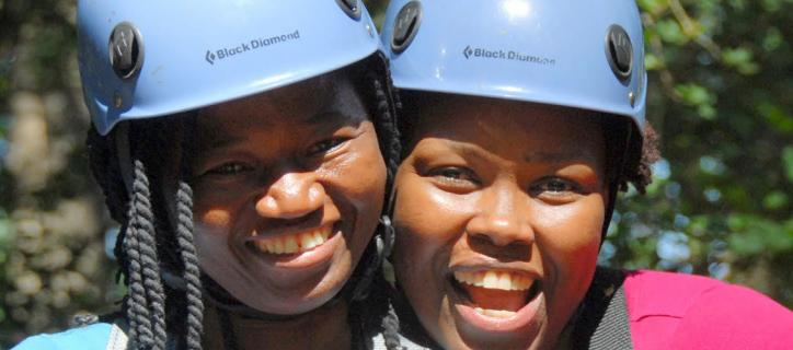Lizzie Kiama (right) and a friend wear helemts and smile for a photo