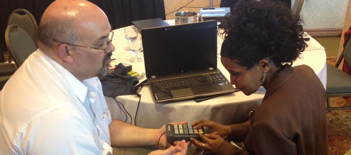 Blind woman from Ethiopia using adaptive voting device