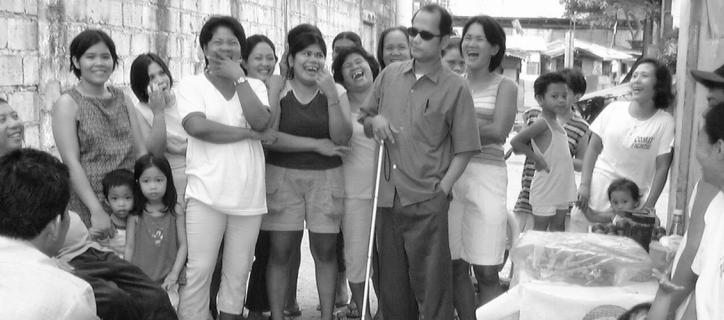A photo of a group of people with and without disabilities smiling in Vietnam