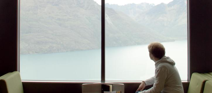 Kevin Cosgrove sits by a window overlooking a body of water