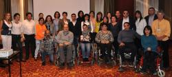 Armenian disability activitst pose for a photo in a conference room in Yerevan after the end of a two-day forum on rights advocacy in October 2015