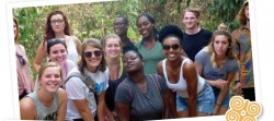 Group of a dozen young adults - men and women, people of color and white, and more - making glamorous or smiling poses in a jungle or forest setting