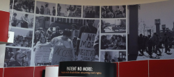 A circular room shows photographs of the section 504 sit-ins with interactive technology.