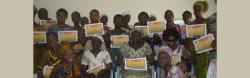 Christiana Yaghr presents certificates to women with disabilities who completed the HIV/AIDS training.