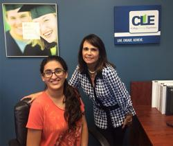 Gabriela at the CLE office smiling with mentor