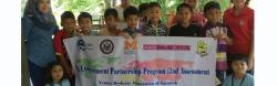 Children holding banner for Empower reading camp