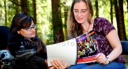 Two women look at the WILD Facilitator's manual