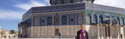 Tory Sampson in front of a colorful Mosque