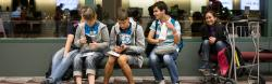 Four students waiting at the airport