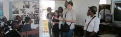 A young American man with autism presents to a classroom of Jamaican children.