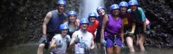 Juanita Lillie with other program participants under waterfalls in rockclimbing gear