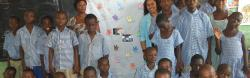 Teresa with students in classroom in Ghana