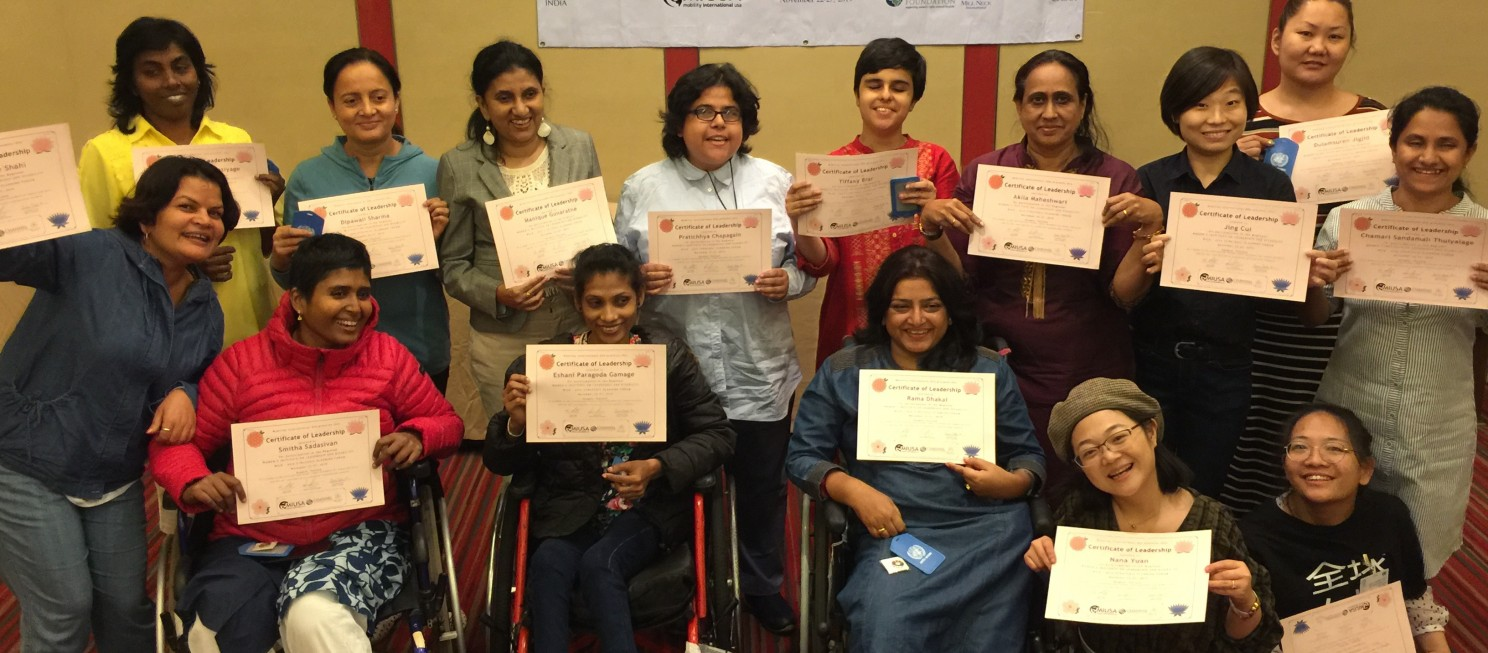A group of WILD delegates hold certificates.