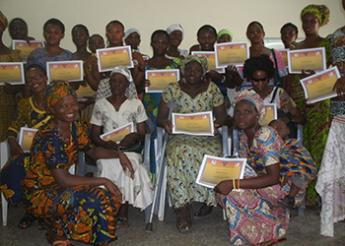 Group photo of participants holding their certificates at the end of the training.