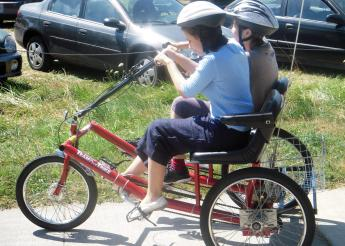 Gumberidze rides a tandem bicycle with another student.