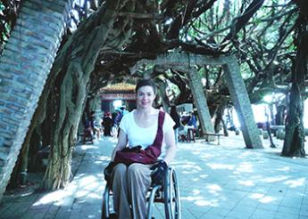 Molly Rogers, a wheelchair user, under trees in Taiwan