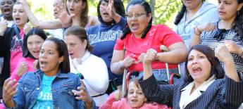 A group of women with disabilities singing