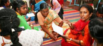 A group of women in India work on an action plan.