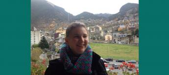 Erinn standing in front of mountains in Spain.