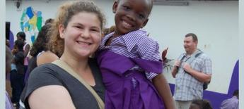 Annie holidng Ghanian child