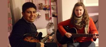 Erinn sitting next to a local Spanish man taking guitar lessons from him.