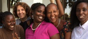 Smiling women at a disability rights training in Tanzania