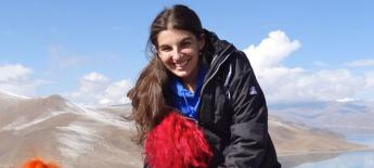 Emily Block Semester at Sea participant with chronic health condition rides a yak high in the mountains