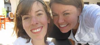 Close up of two young women smiling.