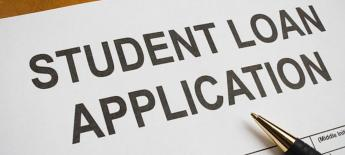 A piece of paper reads Student Loan Application.