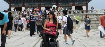 Power wheelchair user on a study abroad site visit in S. Korea