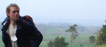 A young blind American man backpacks through the countryside.