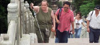 Christi Gilson, who is a blind American, explores Hong Kong with cane and local friend
