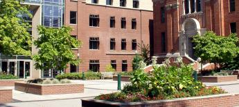 U.S. campus with brick buildings and trees.