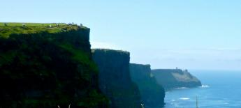 The steep cliffs of Ireland fade away to the sea