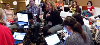 A group of women and men on laptops